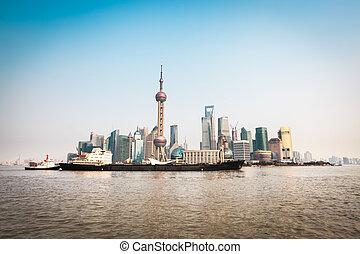 shanghai skyline and cargo ship