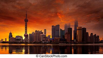 Shanghai skyline and sunset on the Huangpu River