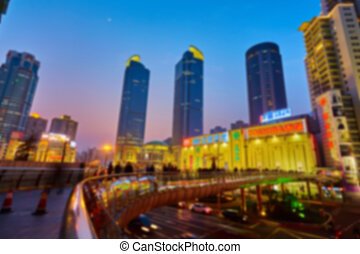 Shanghai skyline at night out of focus. The blur background