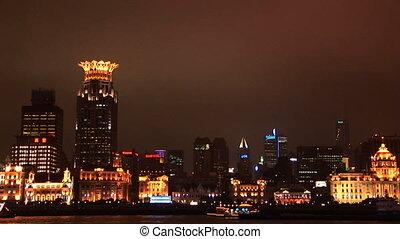 China, Shanghai, The Bund, Huangpu River, skyline at night, zoom out