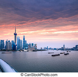 shanghai skyline with huangpu river at dusk - shanghai...