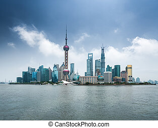 shanghai skyline with huangpu river ,modern city background...