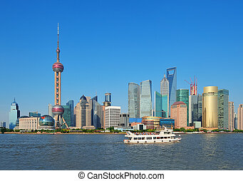 Shanghai skyline with skyscrapers and blue clear sky over...