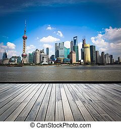 shanghai skyline with wooden floor at daytime,China