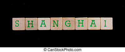Shanghai spelled out in old wooden blocks
