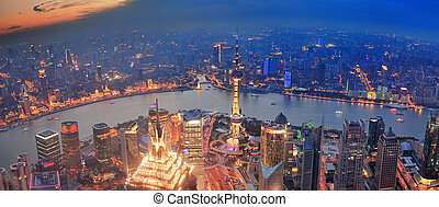 Shanghai sunset aerial view with urban architecture and...