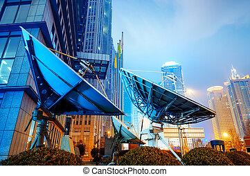 Shanghai's skyscrapers and satellite antenna - Night,...