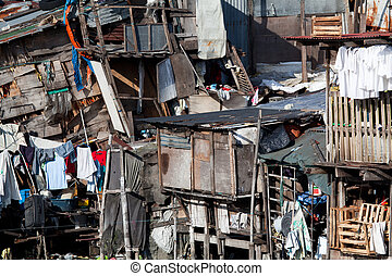 Shanty town - squatter homes. What appears to be a scene of utter disarray and randomness actually portrays several homes. Manila, Philippines. Photo taken using bubble-level.