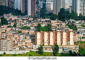 Scenic view of shanty town contrasting with skyscrapers in background, Morumbi neighborhood, Sao Paulo, Brazil.