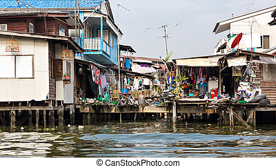 Shanty-town. Slum on dirty canal in Thailand