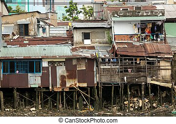 Poor shanti wooden house on the Saigon river bank in Ho Chi Minh city, Vietnam