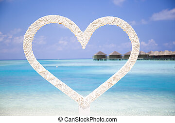 Shape of a Heart in the Beach in Maldives.
