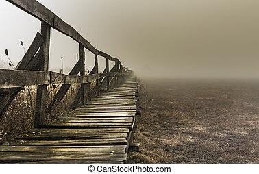 Shape of a pier near a lake, wintertime on a foggy morning, in Sic village, Transylvania, Romania
