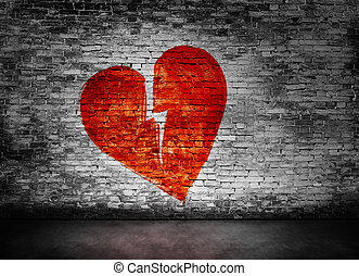 Shape of broken heart on brick wall