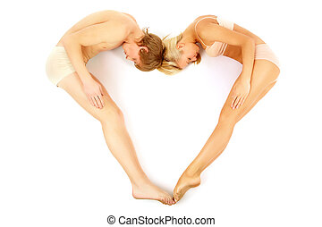 Shape of heart - Creative image of couple lying and forming...