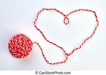 Shape of heart from woolen thread.