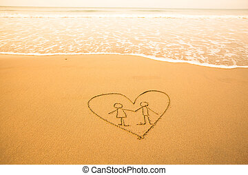 Shape of the pair inside heart of the sea on the beach.