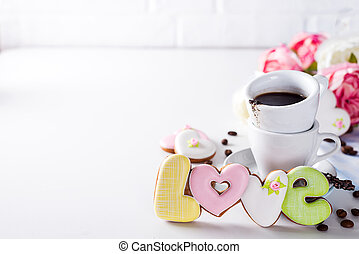 Shaped cookies Love and coffee cup gift on Valentine's Day or Mother's Day, gift, surprise, copy space