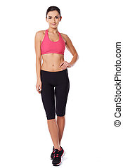 Shapely fit woman in gym tights
