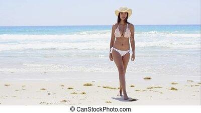 Shapely young woman in a bikini