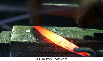 Shaping of metal part in blacksmith workshop - Shaping of...