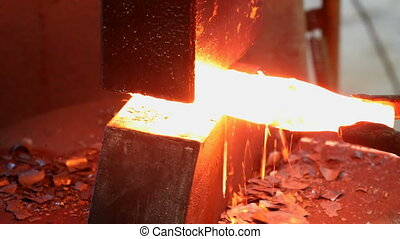 Shaping of metal part on a jackhammer in the blacksmith...