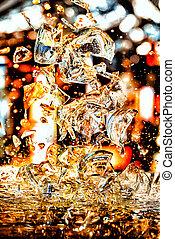 Shards of broken glass on blurry background.