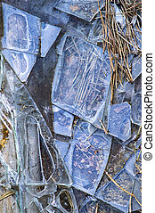 Shards of broken glass on the ground.