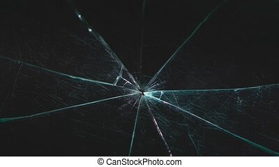 Shards of glass lie on a black table. Close up - Shards of...