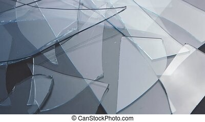 Shards of glass lie on the table. Close up
