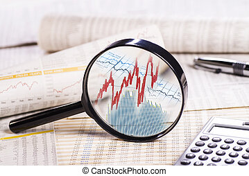 Share Prices - Magnifier sorrounded by several papers with...