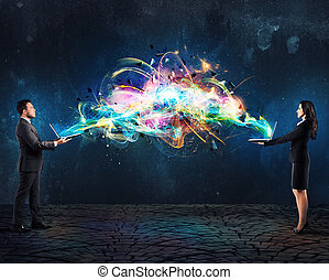 Man and woman link their computers with effects of light waves