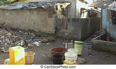 Shared water point, filthy slum dwelling, Conakry - Close up...