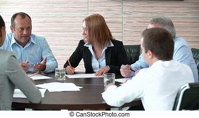 Shareholder Meeting - Pan of business people brainstorming...