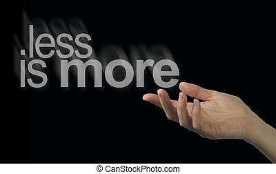 Sharing a less is more philosophy - Female hand appearing to...