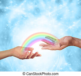 Female hand facing up and male hand facing up with a transparent rainbow connecting them together on a sparkling blue energy formation background