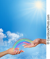 Sharing a Rainbow with you - female hand and male hand...
