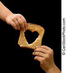 Sharing food with the needy - kids hands with a slice of...