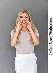Sharing good news. Happy young blond hair woman holding...