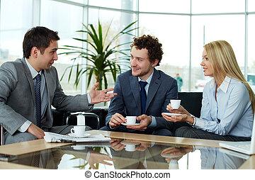 Sharing ideas - Business team sharing ideas during break