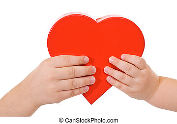Sharing love - Hands holding red heart - love concept -...