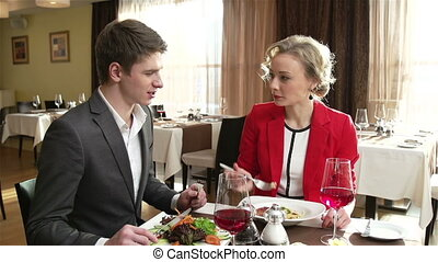 Sharing With Care - Caring couple sharing meal at the...