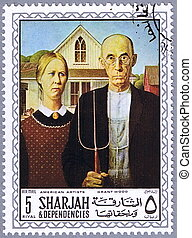 SHARJAH - CIRCA 1968: A stamp printed in Sharjah shows painting of Grant Wood - American Gothic, series, circa 1968