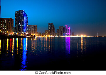 Sharjah downtown night scene with city lights, luxury new high tech town in middle East