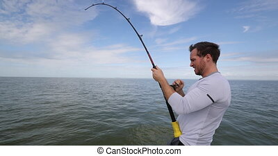 Shark fishing - man sport fishing on boat in Florida. Travel...