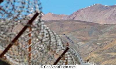 Sharp barbed wires - A scenic shot of barbed wires. The...