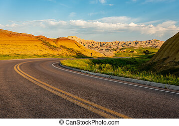 Sharp Curve Through Painted Hills in Badlands