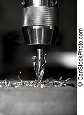 drilling - sharp metal dill in action drilling a hole in a...