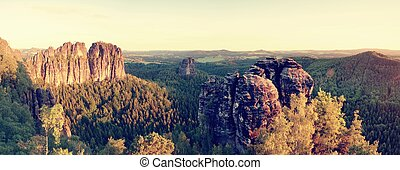 Sharp Schramsteine and Falkenstein rocks in panoramic view. Rocks in the Elbe Sandstone Mountains park
