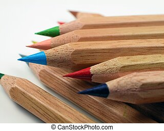 Sharpened Natural Wood Colored Pencils - A pile of freshly...